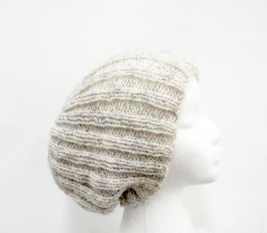 A hand knitted ribbed slouchy beanie hat light tan
