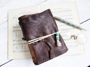 Earthy brown leather journal handbound and stained paper