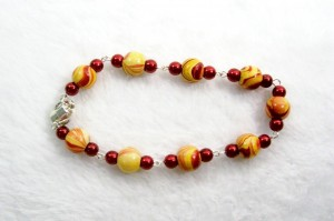 Red Pearl and Wood Eye Pin Bracelet