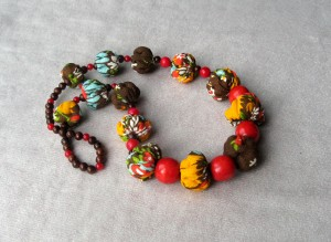 African Beaded necklace Orange natural fabric long Summer with wooden red brown beads