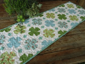 Vintage Style Table Runner, Whirligigs or flowers in cool turquoise. green and white looks fresh and clean!