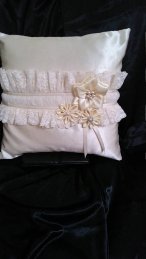 Cream satin and lace cushion with hand made satin ribbon flowers.