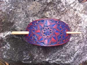 Red and blue hand carved leather hair barrette