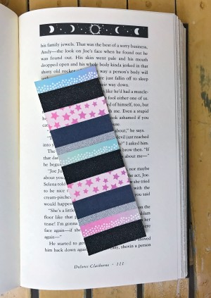 Glittery black, ombre pastels, and star bookmark