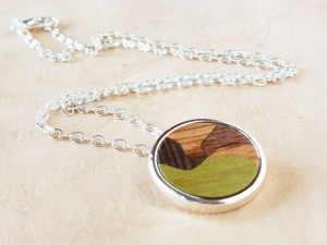 Pendant with Wood inlay and silver plated.