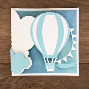 Beautiful Card with Hot Air Balloon Floating Through Clouds