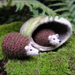 Knitted hedgehogs in cave